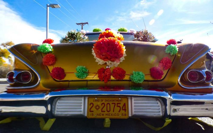 Classic lowrider in the Day of the Dead parade
