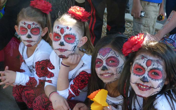 Group of girls watching Day of the Dead parade