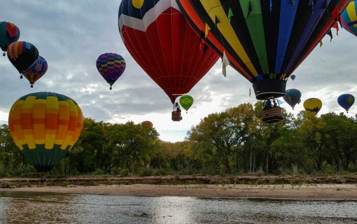 "Balloons ""splash and dash"" in the Rio Grande during balloon fiesta"