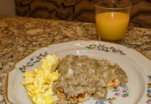 Green chile and cheese biscuits with green chile sausage gravy
