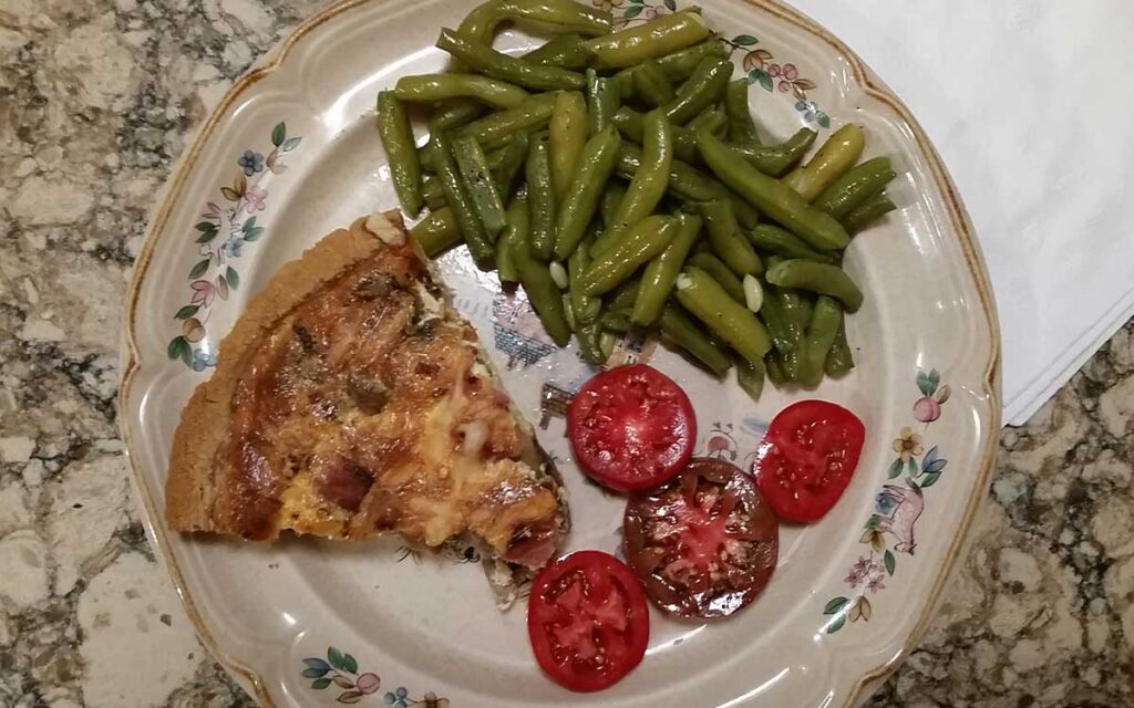 Summer meal of quiche green beans and tomatoes
